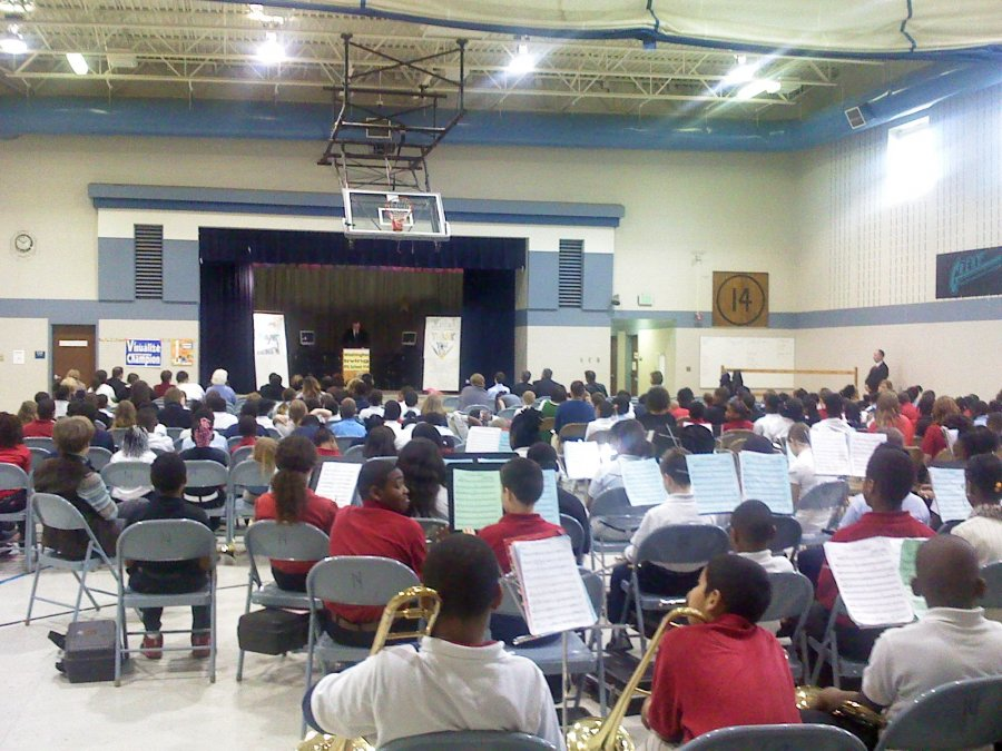 a-band-plays-in-an-official-welcoming-ceremony-in-thanks-to-computers-donated-to-their-school