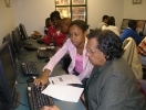 net-literacy-student-volunteers-teaching-at-a-urban-league-computer-lab