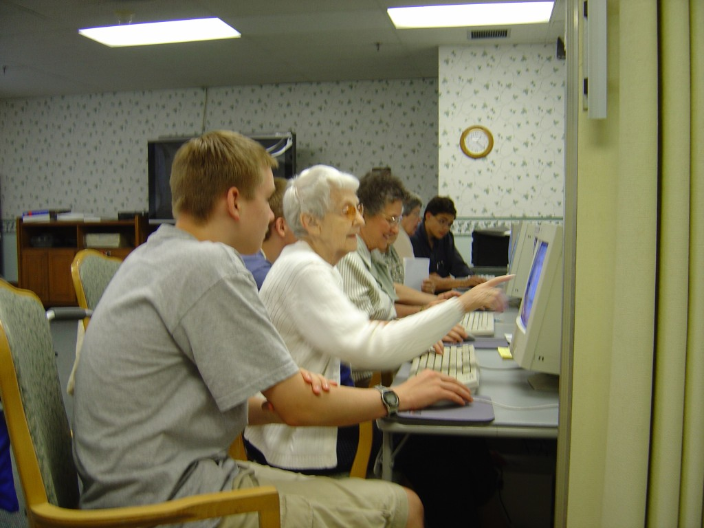 Volunteers teach in computer labs built in senior centers