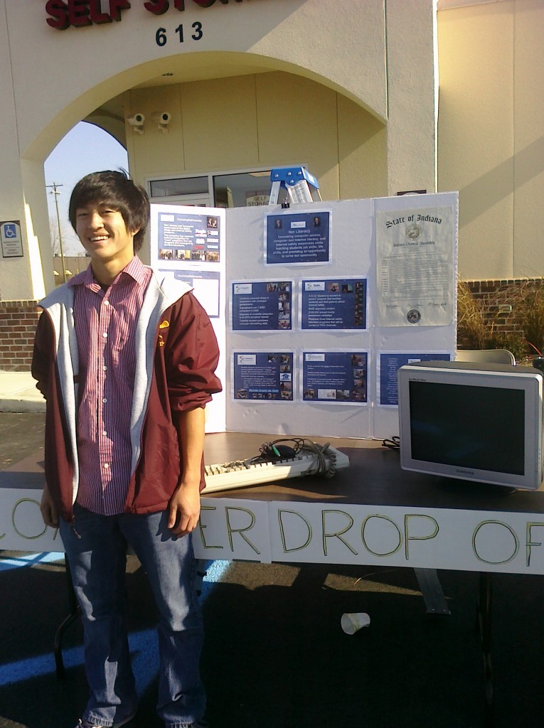 A student volunteer working at a computer drive
