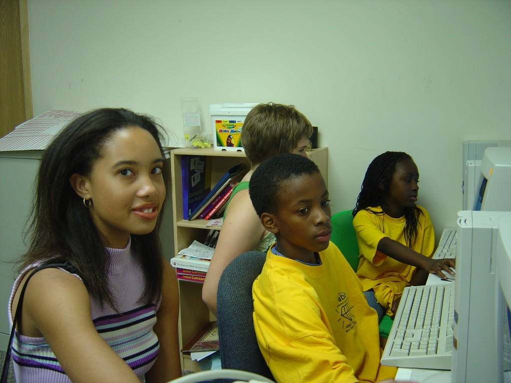 Student volunteers teaching children how to use the Internet safely