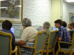 During each training session, students spend time showing seniors how using the Internet will impact their lives