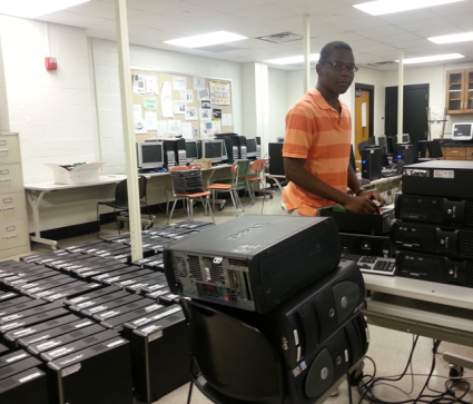 Student Vice Chair Dennis Bacon Loading Win 7 on Computers